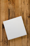 Paper napkin on brown background Royalty Free Stock Photo
