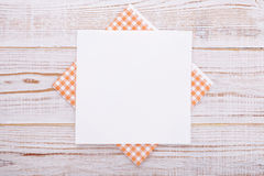 Paper napkin on old wooden table. place for text Royalty Free Stock Photo