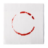 Paper napkin. With a wine stain  on white background Royalty Free Stock Photography