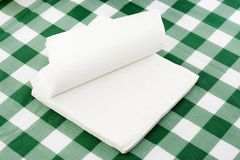 Paper napkins. Stack of paper napkins on top of a tablecloth stock photos