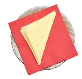 Paper napkins on the black plate Stock Images