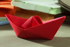Paper napkins and paper boat stock image