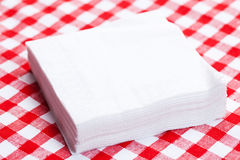 Paper napkins on picnic tablecloth. The paper napkins on picnic tablecloth royalty free stock images