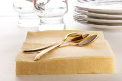 Paper napkins with spoons, plates and glasses Stock Photos