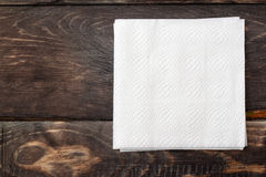 Paper  napkins on wooden surface Stock Photo