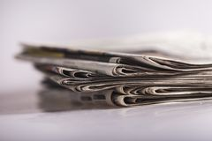 Pile of newspapers on blurred background, close up. Paper news print pile newspapers print media pile of newspapers Royalty Free Stock Photography