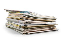 Pile of newspapers on white background. Paper newspaper news pile pile of newspapers print media paper stack Royalty Free Stock Photography