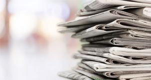 Stack of newspapers on background. Paper newspaper news pile pile of newspapers print media paper stack Royalty Free Stock Photos