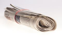 Rolled up newspapers close up on light background. Paper newspaper news roll newspapers rolled up print media Stock Photos