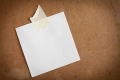 Paper not. E on brown wood background Stock Image