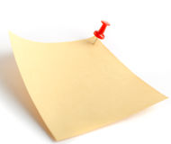 Paper note. It is attached red pin on a white background Royalty Free Stock Photo