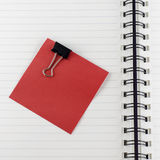 Paper note with clip on notebook Royalty Free Stock Photos