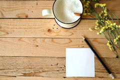 Paper note and cup of fresh milk Stock Photo
