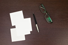 Paper note with pen and glasses Stock Photography