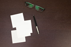 Paper note with pen and glasses Royalty Free Stock Image