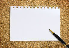 Paper note and pen on sand for texture background Stock Images