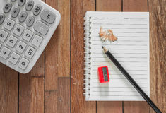 Paper Note With Pencil And Calculator. On Wooden Background Stock Images
