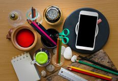 Paper for note, pencil, pen, coffee, clock and smartphone put on wooden board using wallpaper or background for business work.  stock images