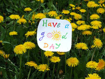 Paper note with phrase: Have a good day. Positive attitude concept. Paper note with phrase: Have a good day Stock Photography