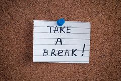 Paper note with the phrase Take a Break! on bulletin board Stock Photography