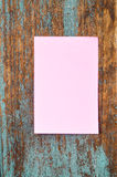 Paper note on plank wood background Royalty Free Stock Photo