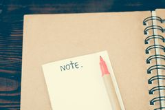 Paper note and red pen on dairy Stock Photography