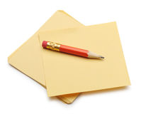 Paper note and a red pencil Stock Photography