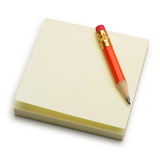 Paper note and a red pencil Royalty Free Stock Photos