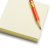 Paper note and a red pencil Royalty Free Stock Photo