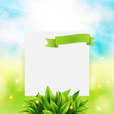 Paper note with ribbon and leaves on bright summer background. V Royalty Free Stock Image