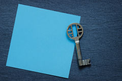 Paper note with vintage key Royalty Free Stock Photo