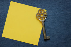 Paper note with vintage key Stock Image