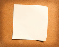 Paper note on wood. Background Stock Photo