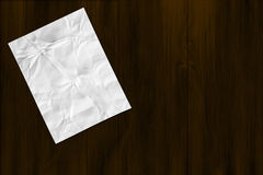 Paper note on wood background Royalty Free Stock Photo