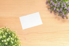 Paper note on wood background Stock Image