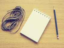 Paper note on wood dish with pencil and recycle rope Stock Image