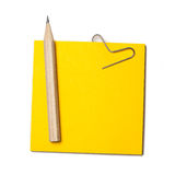 Paper note and a wood pencil. It is isolated on a white backgrou Stock Photos