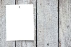 Paper note, wooden background Stock Photo