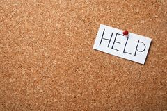 Paper note with word HELP on cork board. Space for text stock photo