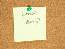 Paper note written with GREAT WORK inscription on cork board. Royalty Free Stock Image