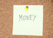 Paper note written with MONEY inscription on cork board Stock Photo
