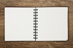 Paper notebook. On wooden floor Stock Photography