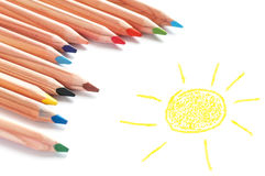 Colored pencils and sketch pad Stock Photos