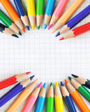 Paper notebook with colored pencils Royalty Free Stock Images
