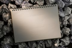 Paper notebook on crumpled paper Stock Image