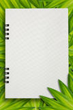 Paper notebook on leaves for text Stock Images