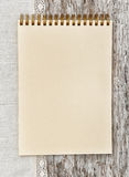 Paper notebook and linen fabric on the old wood Royalty Free Stock Photo