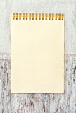Paper notebook and linen fabric on the old wooden background Royalty Free Stock Images