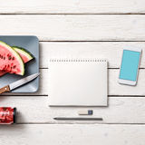 Paper notebook with mockup of smartphone Stock Photos