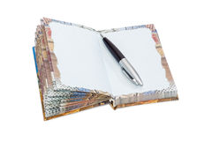 Paper notebook and a pen on a light background Royalty Free Stock Image